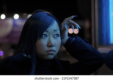 Portrait of pretty asian girl outdoors at night city
