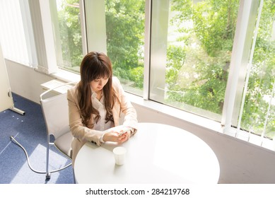 a portrait of pretty asian woman with cup