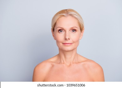 Portrait of pretty, attractive, charming, blonde, shirtless, nude woman with perfect skin, isolated on grey background, looking at camera, after peeling, lotion, mask, perfection, hydration concept