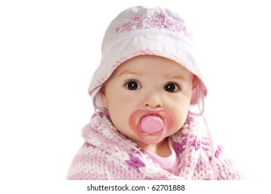 Portrait if pretty baby girl  with baby's dummy isolated on white background