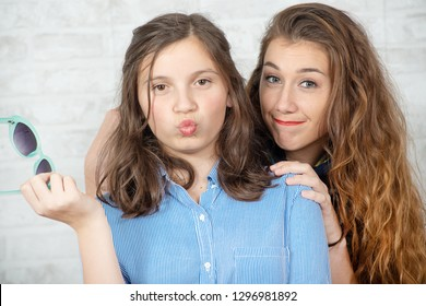 a portrait of pretty beautiful charming  adorable with long hair girl and her older friend