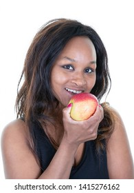 Portrait of pretty black woman eating taking bite of red apple