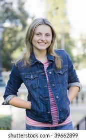 Portrait of a Pretty Blond Teen Girl in Jean Jacket