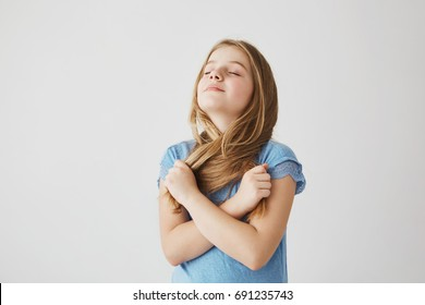 A portrait of pretty blonde girl taking deep breath of fresh air.