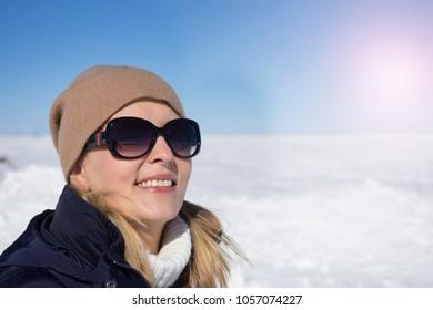 Portrait of pretty blonde woman by winter