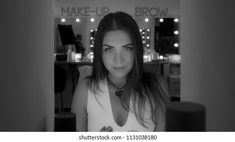 Portrait of pretty brunette with professional makeup in black and white colors