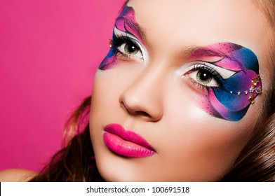 portrait of pretty brunette woman with bright face art