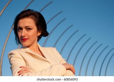 Portrait of a pretty business woman against blue sky background