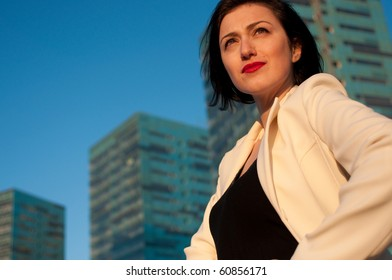 Portrait of a pretty business woman against architecture background
