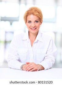 Portrait of a pretty business woman looking happy -