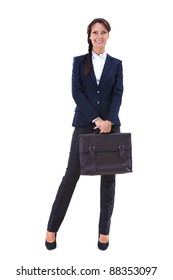 Portrait of pretty businesswoman with briefcase posing before camera in isolation