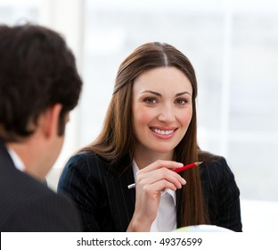 Portrait of a pretty businesswoman and her colleague in a meeting