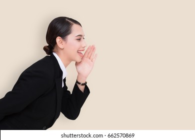 portrait of pretty businesswoman loud screaming or calling out to someone