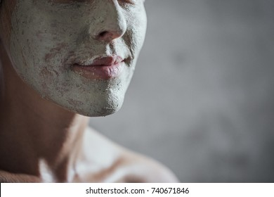 Portrait of pretty Caucasian woman with spa face mask.