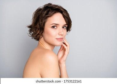 Portrait of pretty charming attractive girl look in mirror touch hands face enjoy her soft ideal perfect skin after anti aging rejuvenation procedure isolated over gray color background