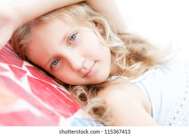 portrait of a pretty child girl blonde on outside
