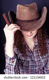 portrait of pretty curly red-haired girl with a cigar