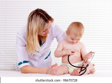 portrait of a pretty doctor with baby