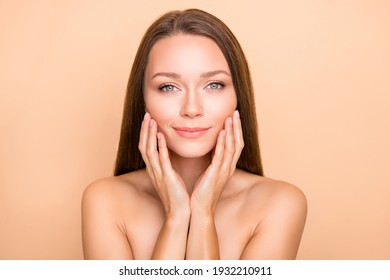 Portrait of pretty dreamy girl touching pure skin domestic pamper daily care isolated over beige pastel color background