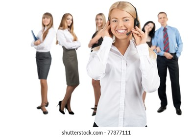 Portrait of a pretty female call center employee with colleagues standing in the background