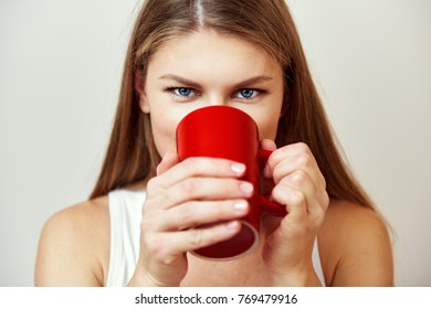 Portrait of pretty female drinking hot tea. Healthy lifestyle.
