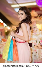 Portrait of a pretty female shopper