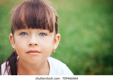 Portrait of a pretty girl with big beautiful eyes looking into the camera