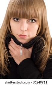 Portrait of pretty girl in black overcoat. isolated over white, close-up