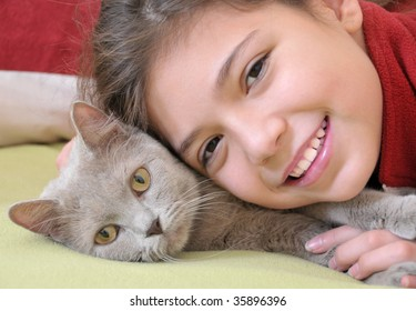 Portrait of pretty girl with cat