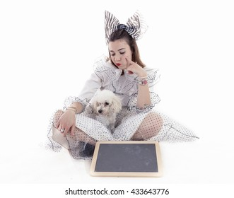 portrait of pretty girl dressed funny clothes and her little dog