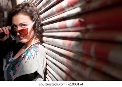 Portrait of the pretty girl near the graffiti wall