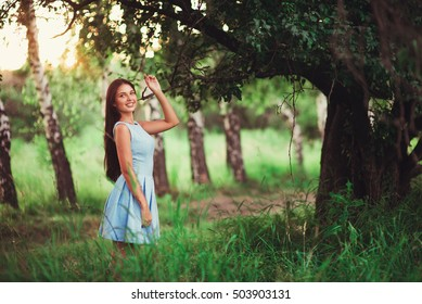 Portrait of pretty girl near the tree in the park. Concept of youth and natural beauty. soft focus