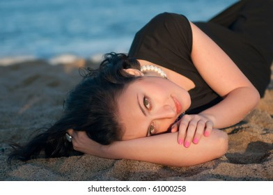 Portrait of a pretty girl resting on the sand