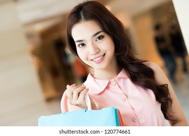 Portrait of a pretty girl with shopping bags