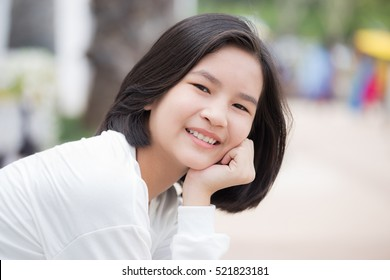 Portrait of pretty girl smiling at camera