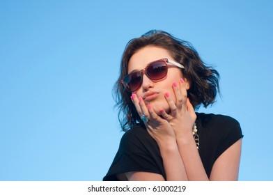 Portrait of a pretty girl with sun glasses