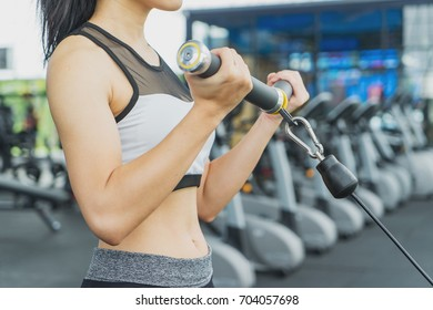 Portrait of pretty girl training on special sport equipment in gym