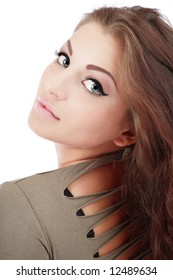 Portrait of pretty girl with trendy makeup looking over her shoulder