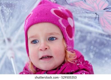 Portrait of pretty girl with umbrella, winter park, outdoor.