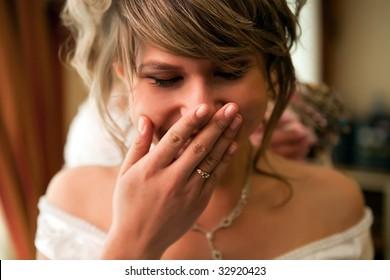 Portrait of pretty laughing bride