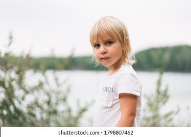 Portrait of a pretty little girl in nature