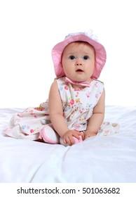 portrait of a pretty little girl in a pink dress