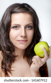 portrait pretty long-haired woman hands yellow apple. On white background