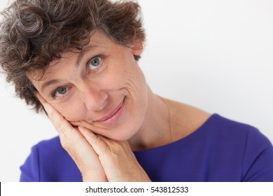 Portrait of pretty mature woman leaning on hands