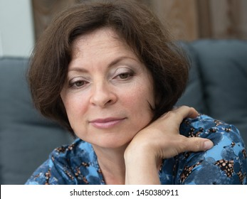 Portrait pretty middle aged woman sitting in an outdoor garden