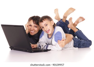 portrait of a pretty mom and son with laptop