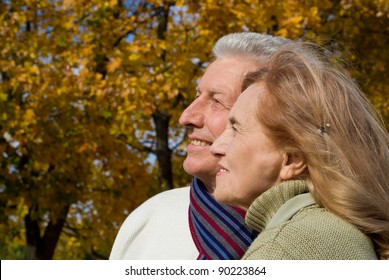 portrait of a pretty old couple posing at nature