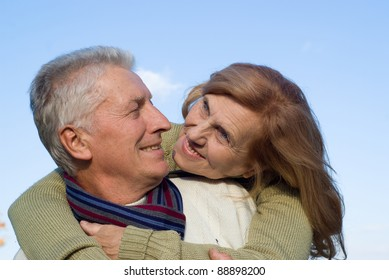 portrait of a pretty old lovers at sky
