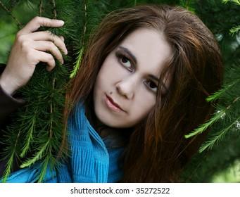 Portrait of pretty  plump woman with long dark hair