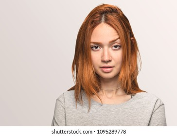 portrait of a pretty redhead girl serious